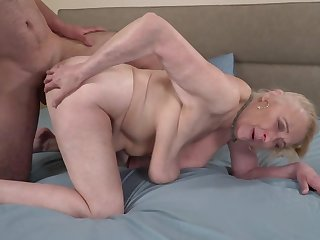 A big hairy clothes-horse is fucking a horny elderly granny on burnish apply bed