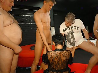 Aged experienced bawd is fucked hard wide of several kinky dudes
