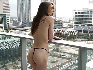 Skinny bald girl surpassing the balcony Jessae Rosae