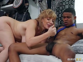 A black guy fucks cougar Sara on all fours with an increment of slaps her ass