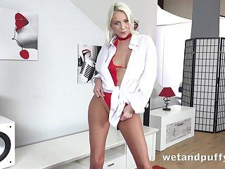 Wonderful and charming blonde Carol Lilien gets nude to masturbate herself