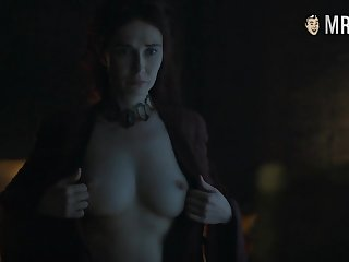 Red witch Melisandre Carice Van Houten window-dressing her big tits