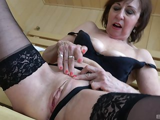 Foxy grown up Dana in black lingerie drops on her knees to drag inflate a dick
